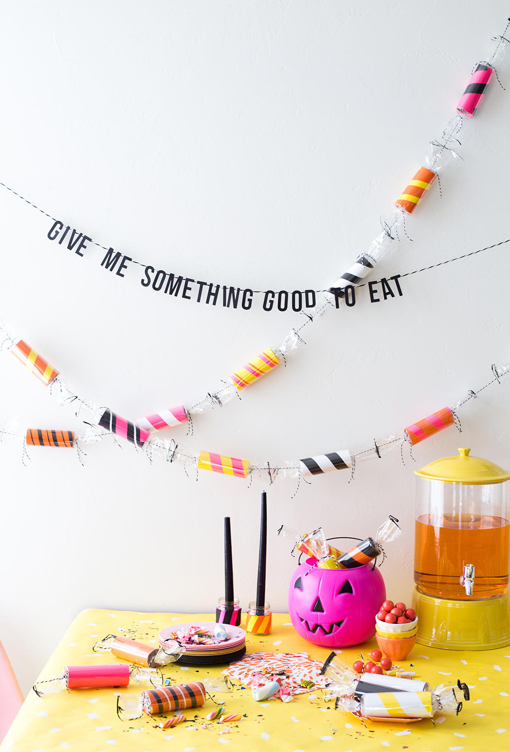 Toilet paper roll candy garland for Halloween #colorizeyourparty with Astrobrights