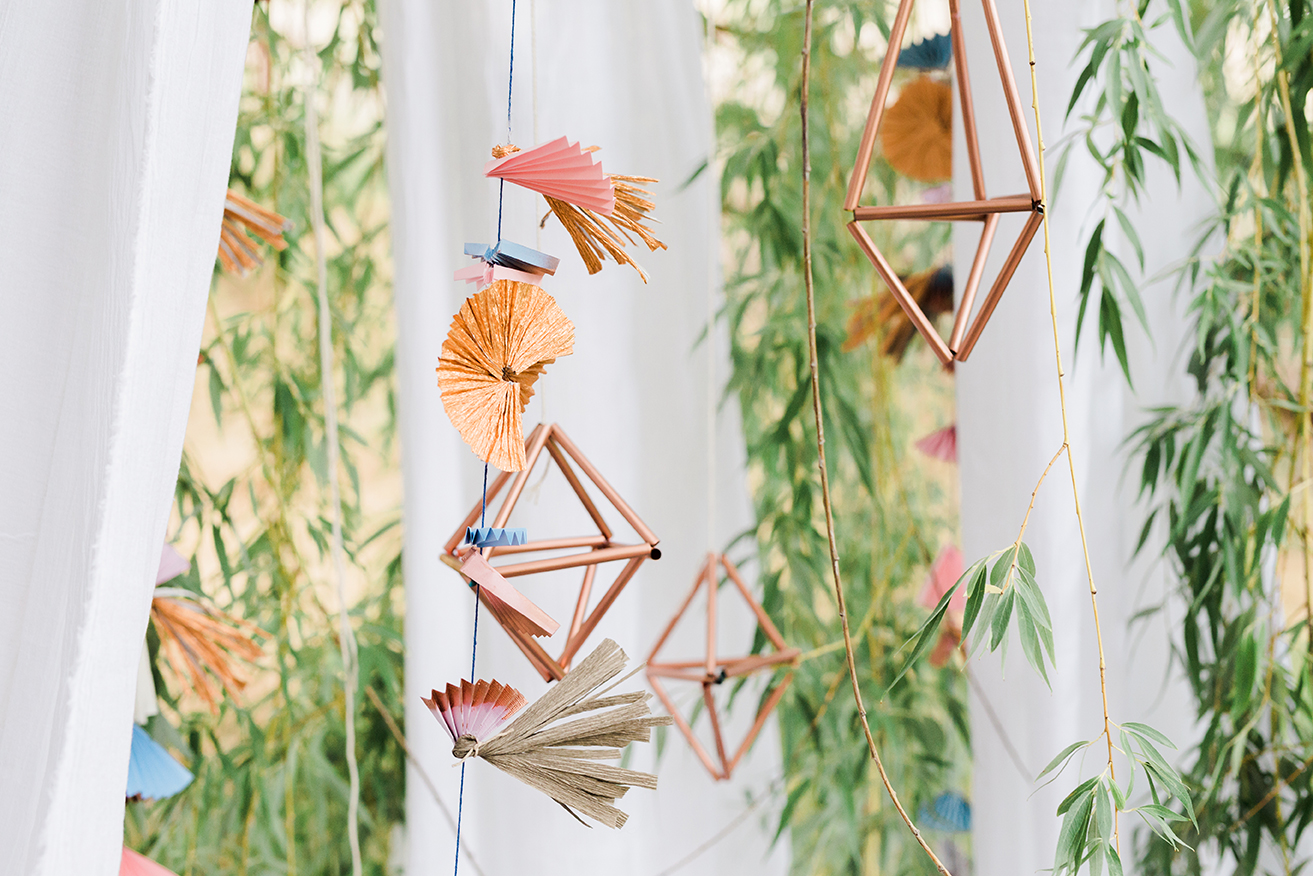 geometric copper hangings with straws
