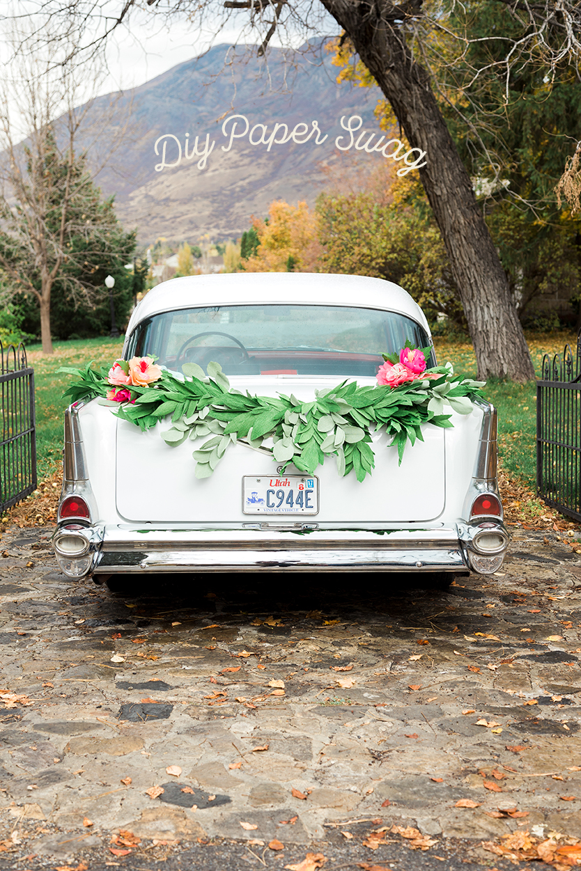 DIY paper garland swag for wedding get away car
