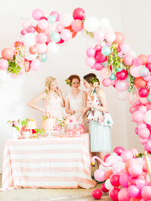 Flamingo Pop. A bridal collaboration with BHLDN and The House That Lars Built. Balloons installation by Brittany Watson Jepsen. Florals by Tinge Floral. Dresses from BHLDN. Top from Anthro. Tablecloth from Anthro. Photo by Jessica Peterson.