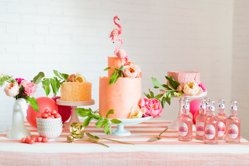 Flamingo Pop. A bridal collaboration with BHLDN and The House That Lars Built. Flamingos from BHLDN. Tablecloth, duck vase, gold serverware from Anthro. Cake stands from BHLDN. Rose lemonade from Pop 'n Sweets. Florals by Tinge. Photo by Jessica Peterson.