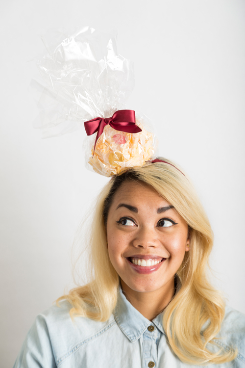 Start a new tradition of making hats for each other to wear on Thanksgiving like this popcorn ball fascinator.