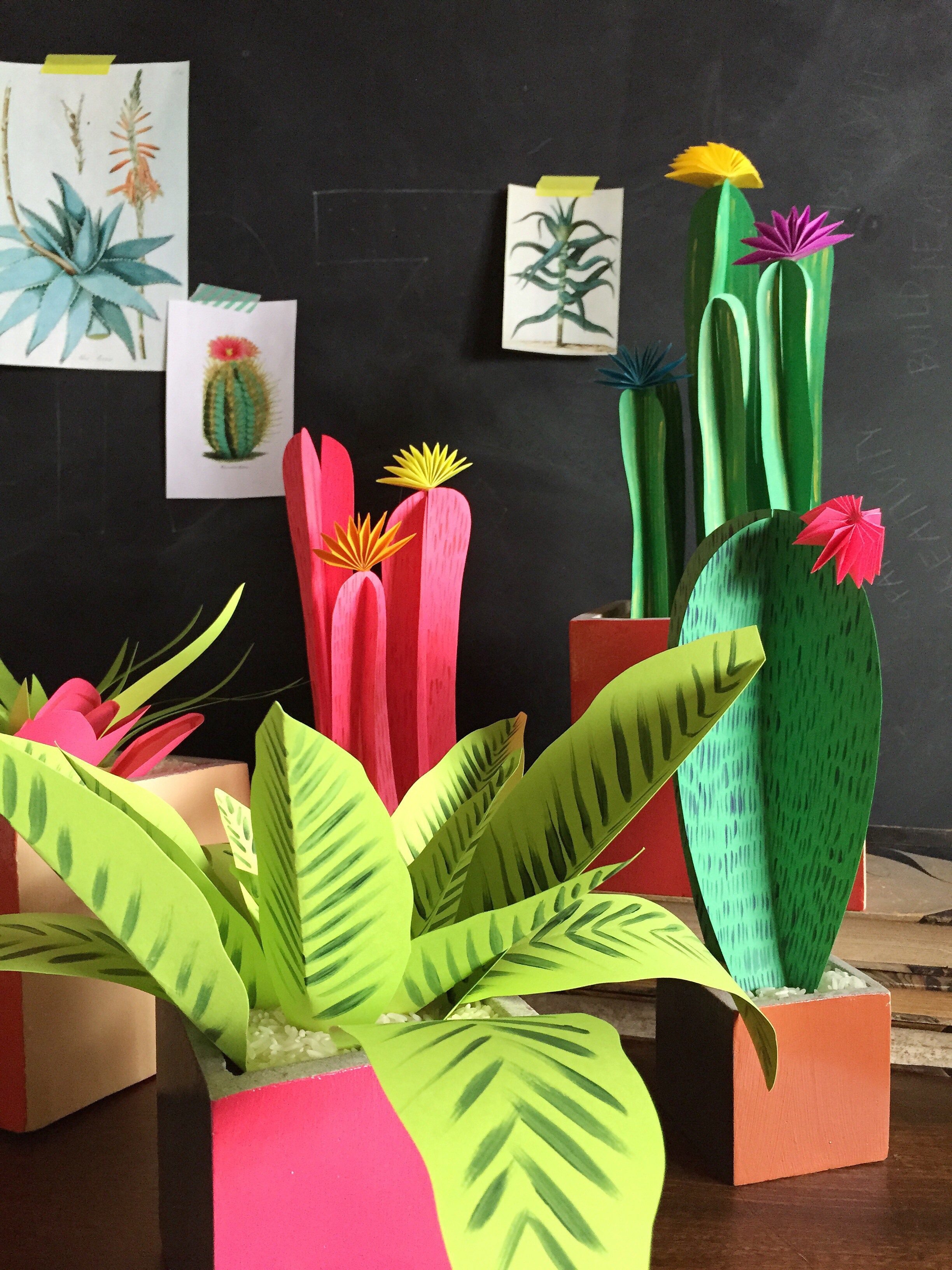 Colorful paper plants in a grey room