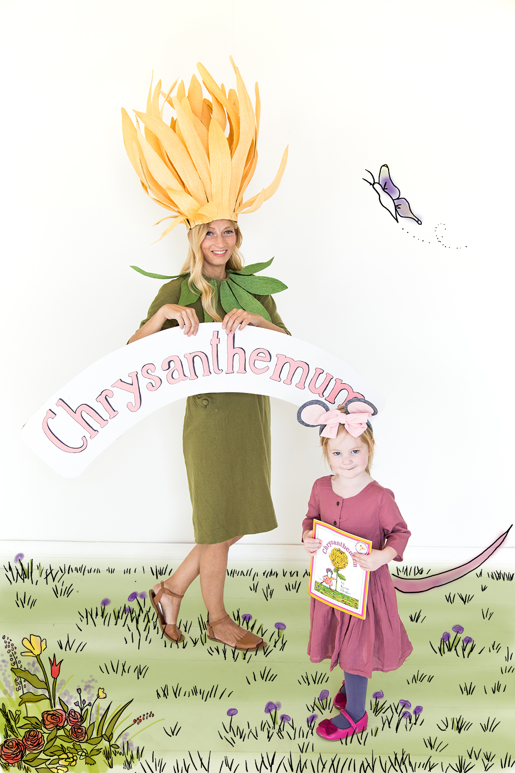 A mom wearing a paper flower costume and a daughter dressed as a mouse pose in their costumes
