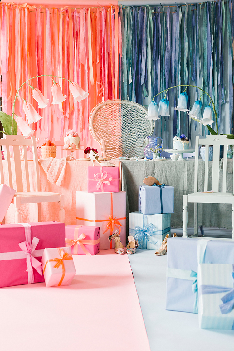 A pink and blue space divided down the middle with flower bells in each color