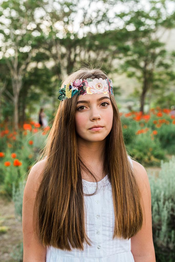 A girls wears a flower crown.