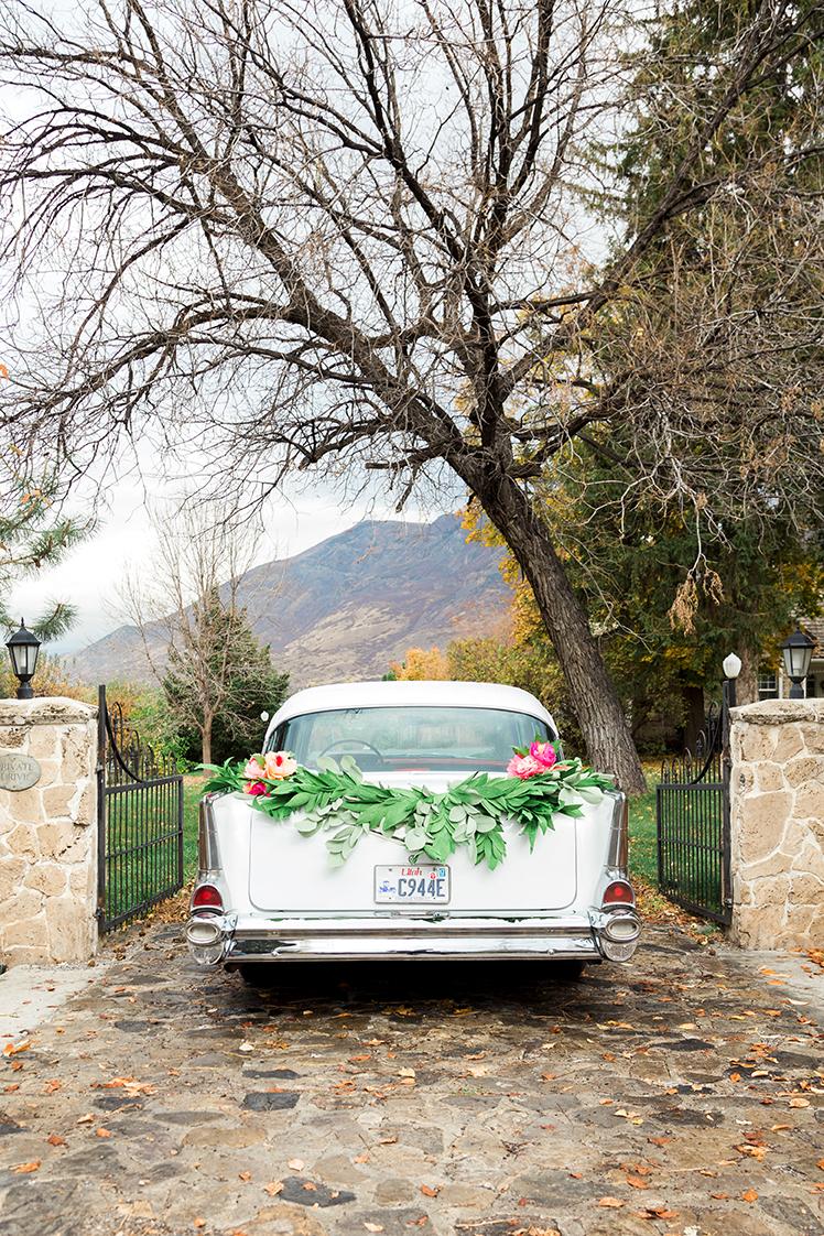 DIY paper garland swag for wedding get away car