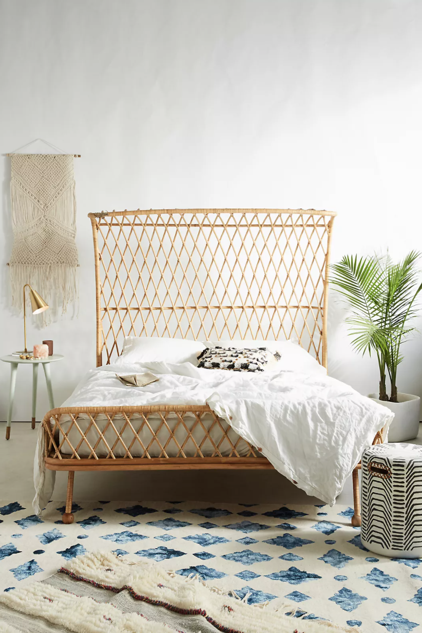 Dramatic Rattan bed with a criss-crossing rattan headboard