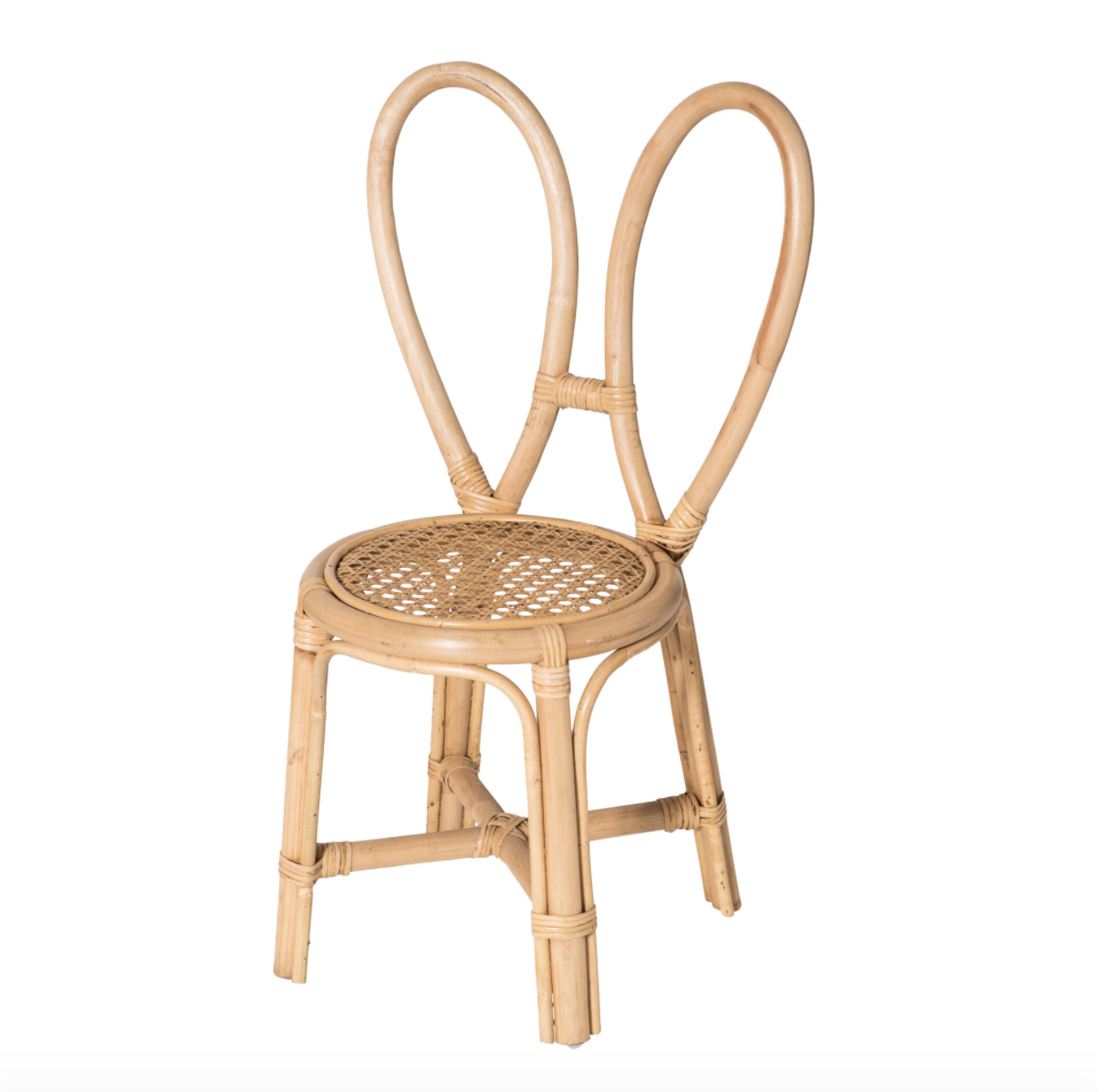 A rattan chair whose back is designed to look like bunny ears in a white space.
