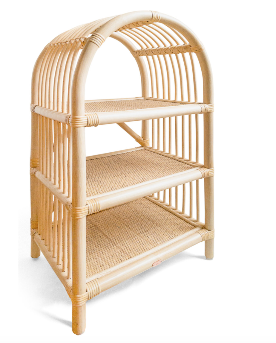 A rattan arch-shaped shelving unit with three shelves.