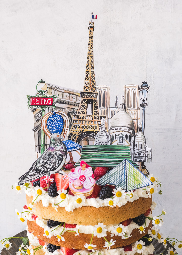 Paris cake topper with watercolor illustrations on a summer cake with flowers and berries