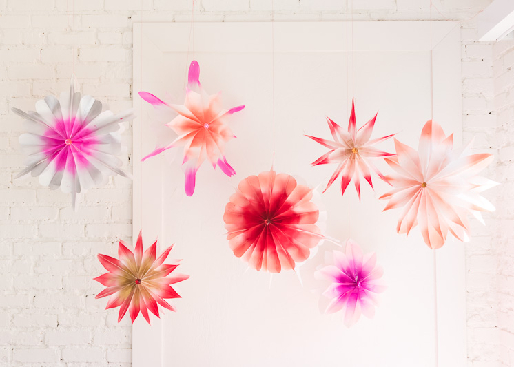 Vibrant multi-color fans hang from ceiling.