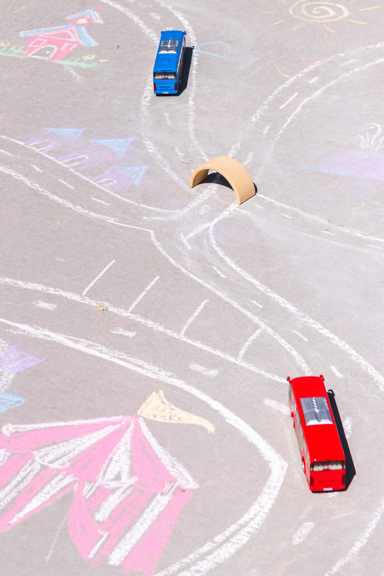 draw a city map for cars with sidewalk chalk