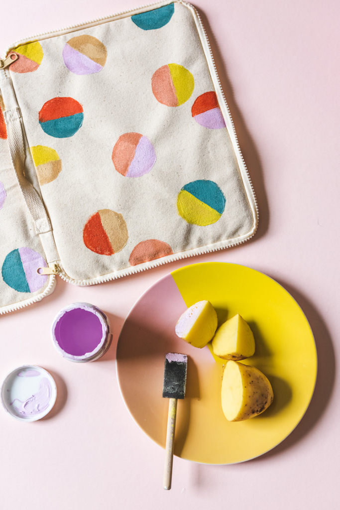 Using potatoes and paint to stamp fabric.