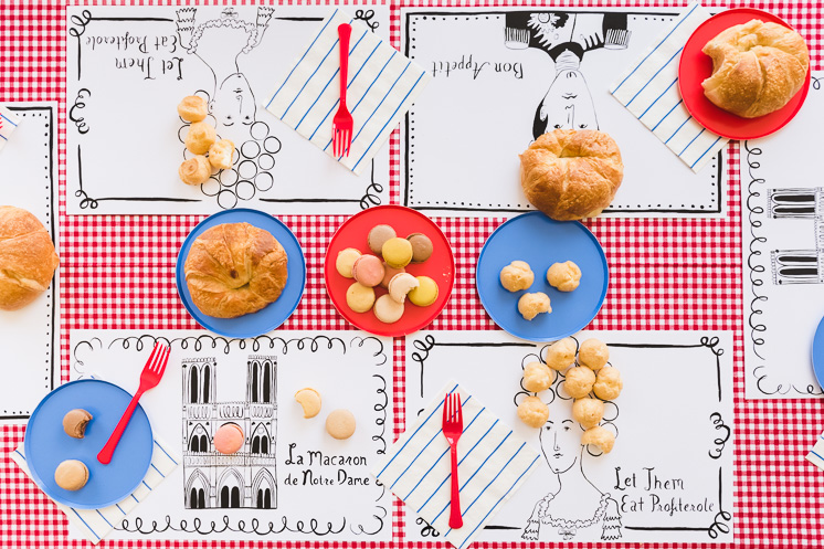 French placemats sit on a festive table.