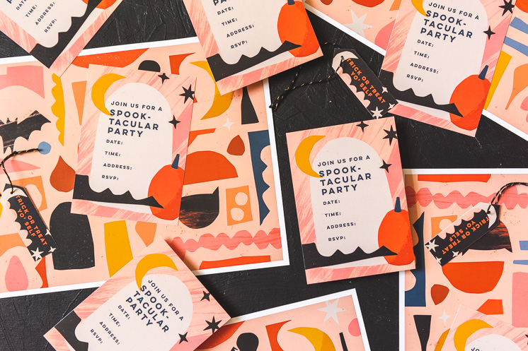 Paper party goods with a halloween theme on a black background. They're orange, yellow, black, white, navy, and peach.