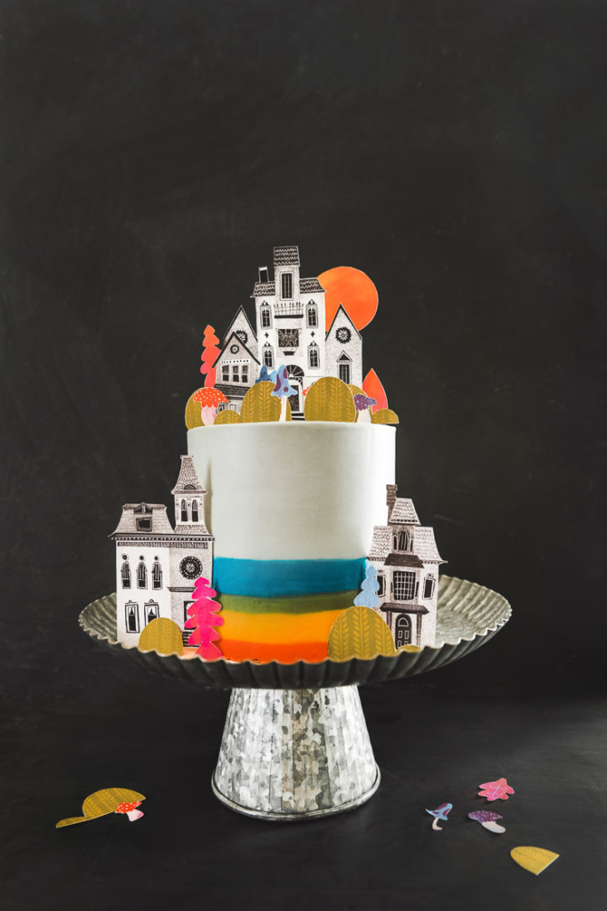 a colorful, cute printable cake topper set on a cake.