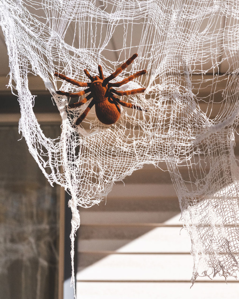 DIY: Turn gauze into spiderwebs