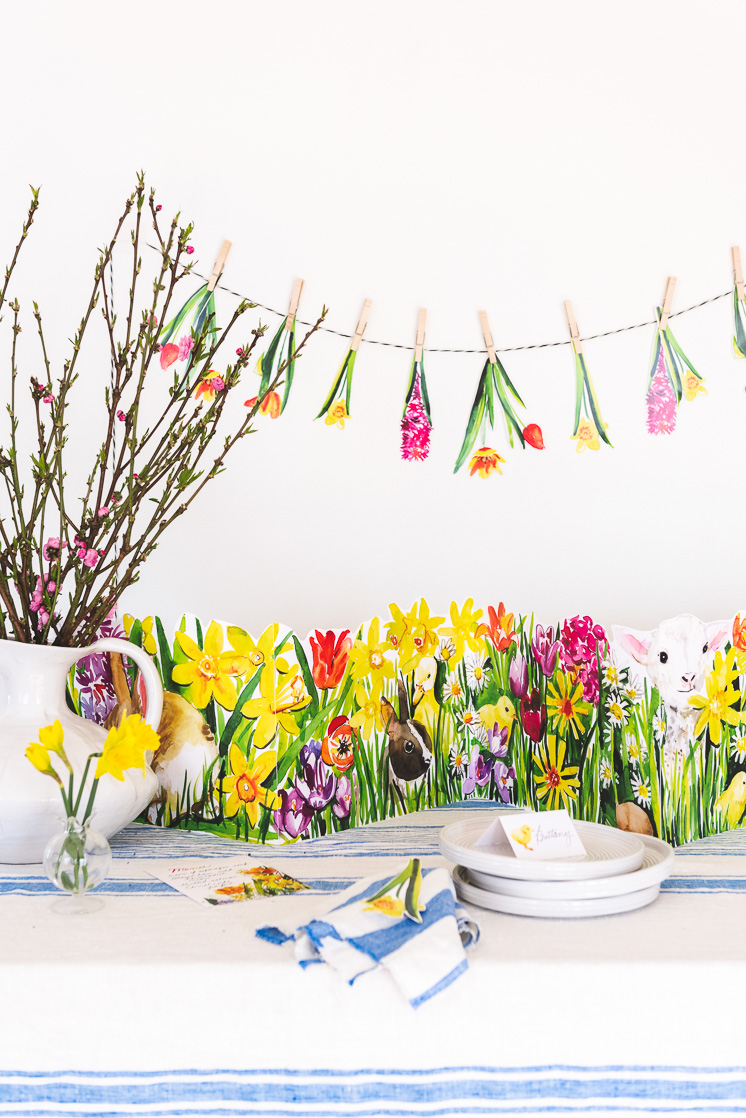 Easter printable tablescape with flowers and rabbits and a floral garland.