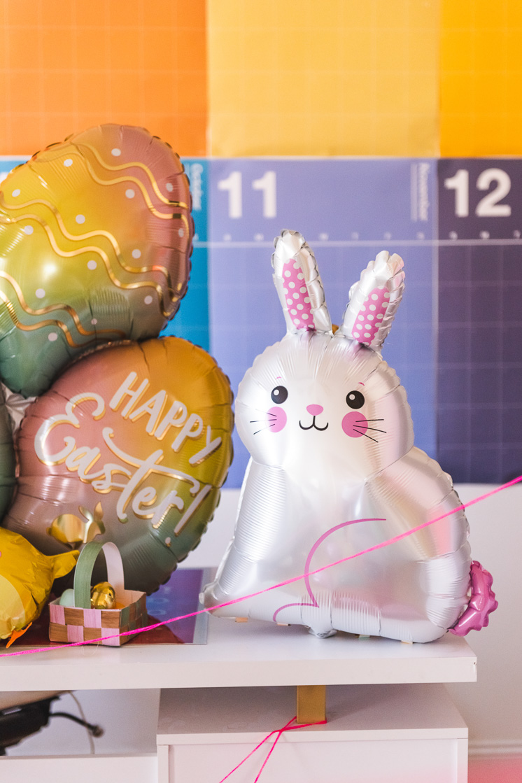 Photo of an Easter bunny balloon in a colorful room.