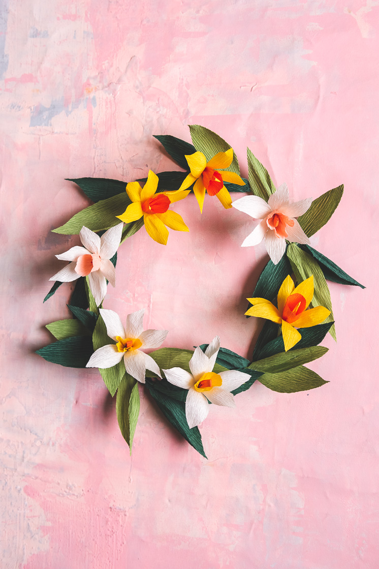 Paper daffodil wreath against a pink background