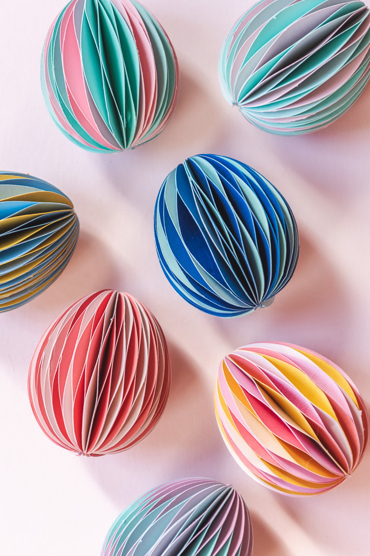 Honeycomb Easter eggs in pink, yellow, blue, and green on a blush pink background.