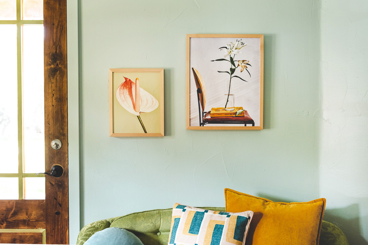 Floral prints by Chaunte Vaughn on a mint green wall
