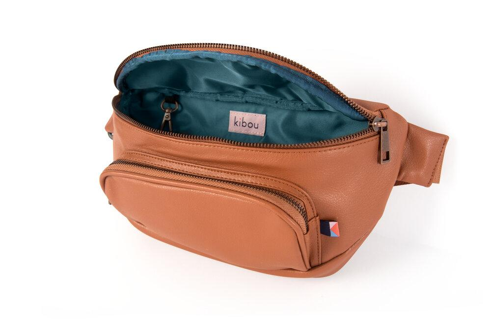 A warm brown fanny-pack style diaper bag.