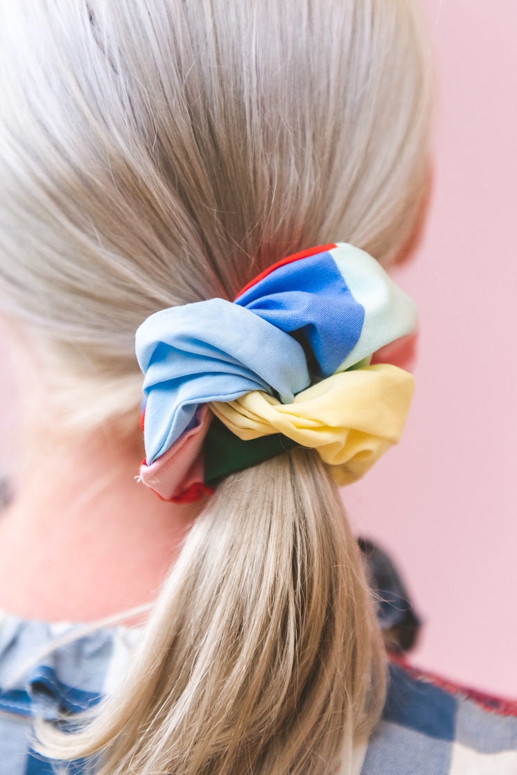 Brittany wearing a patchwork scrunchie in her hair.