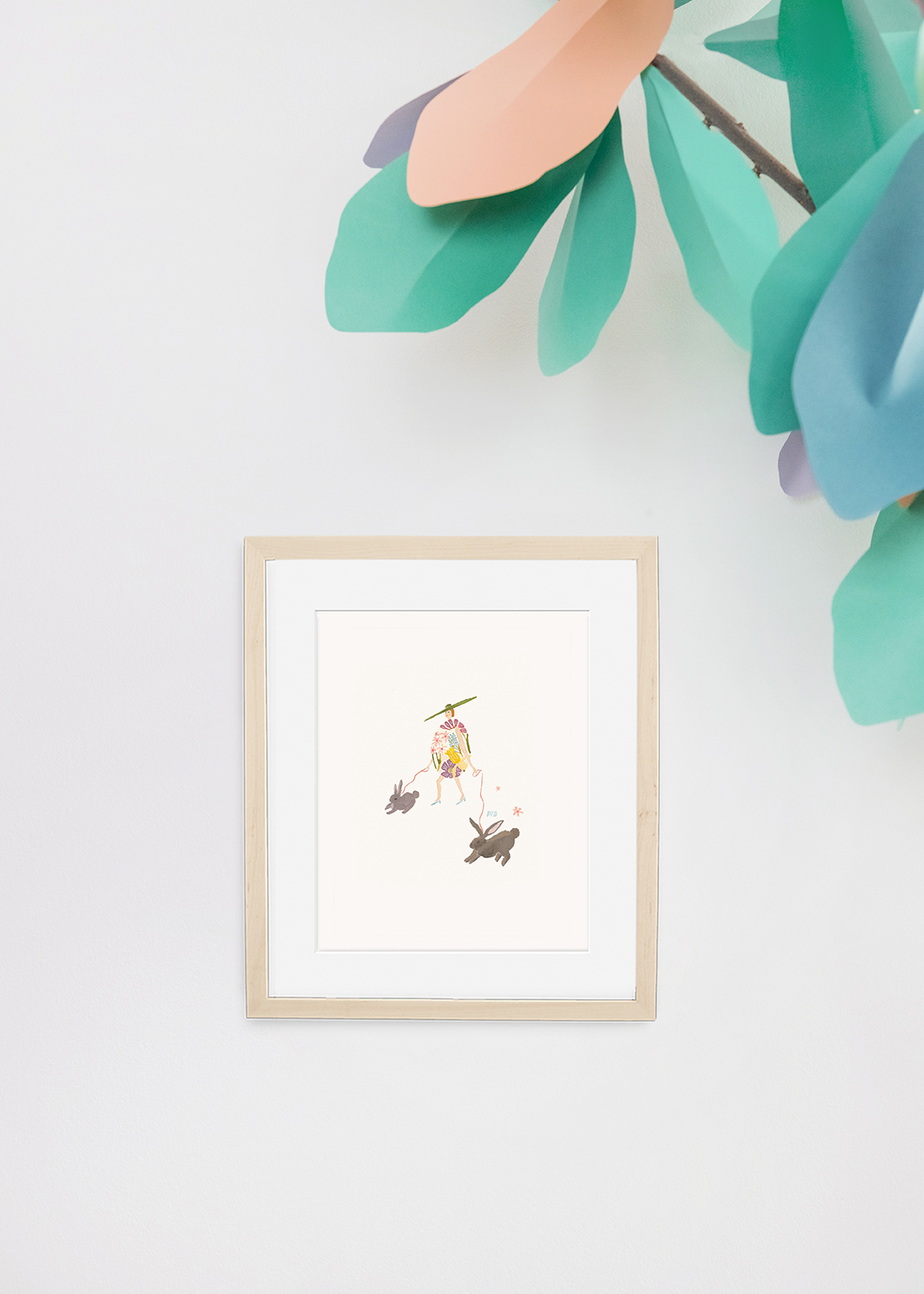 Art print of Easter Egg Lady by Monica Dorazewski on a white background with a paper tree on the side.