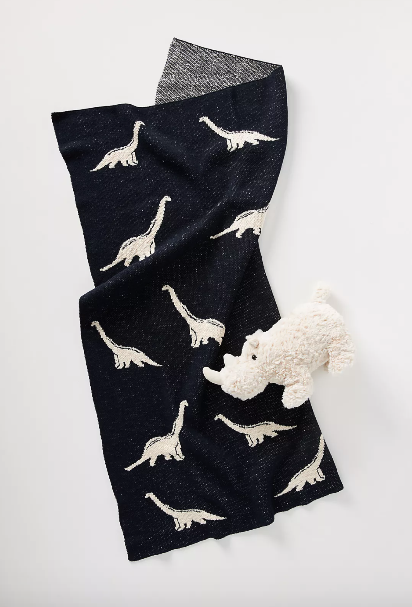 dark blue blanket with white dinosaurs.