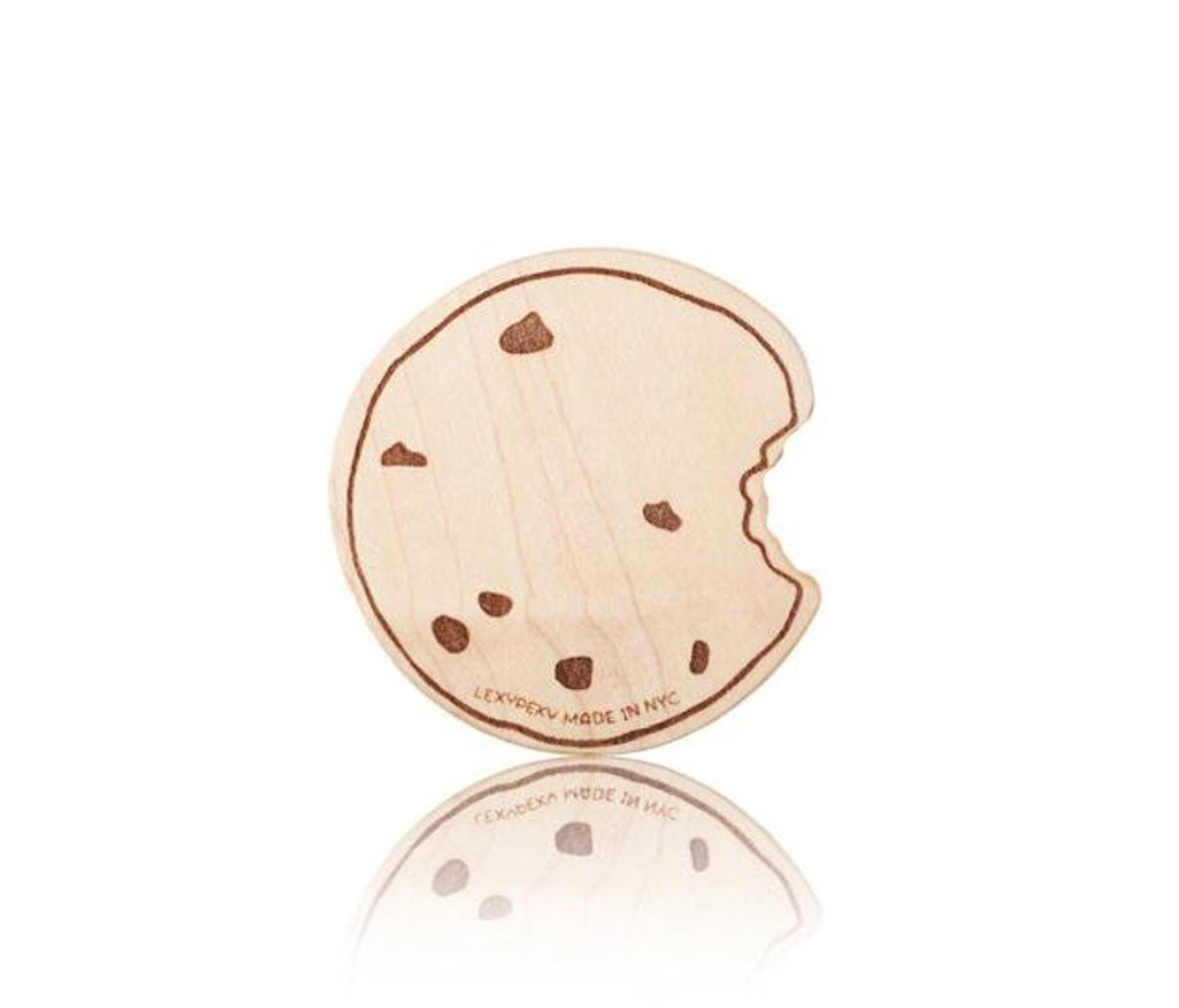 A wooden cookie teething toy on a white background.