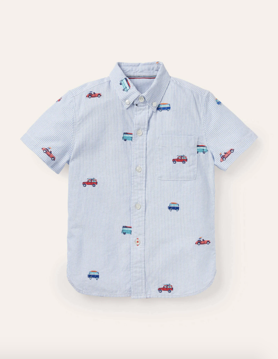 Blue button up shirt with cars and trucks embroidered on it