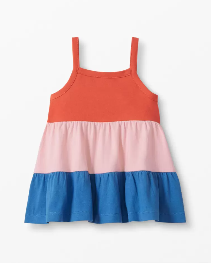 a gathered tanktop with red, pink, and blue colorblock stripes