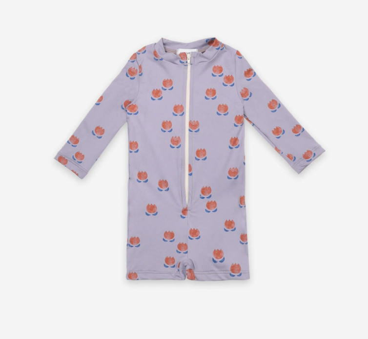 lilac-colored long sleeved swimsuit with a zip down the front and tulips printed on it