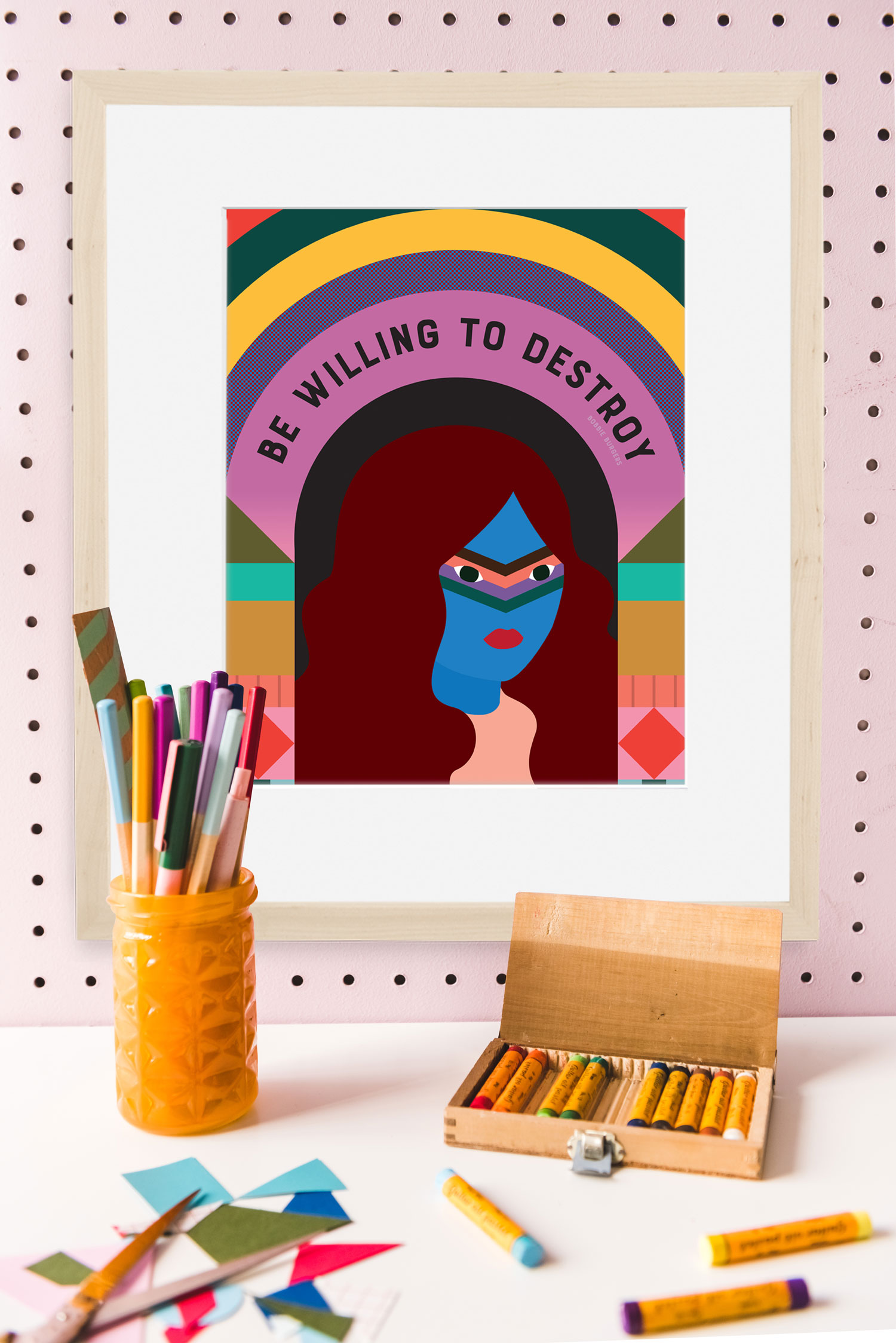"Graphic portrait of a woman with the text ""be willing to destroy"" among art supplies on a pink wall"