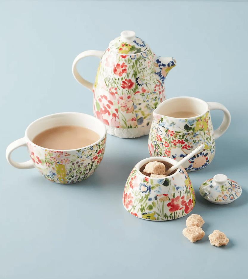 A modular floral tea set, complete with teapot, teacup, sugar bowl, and creamer