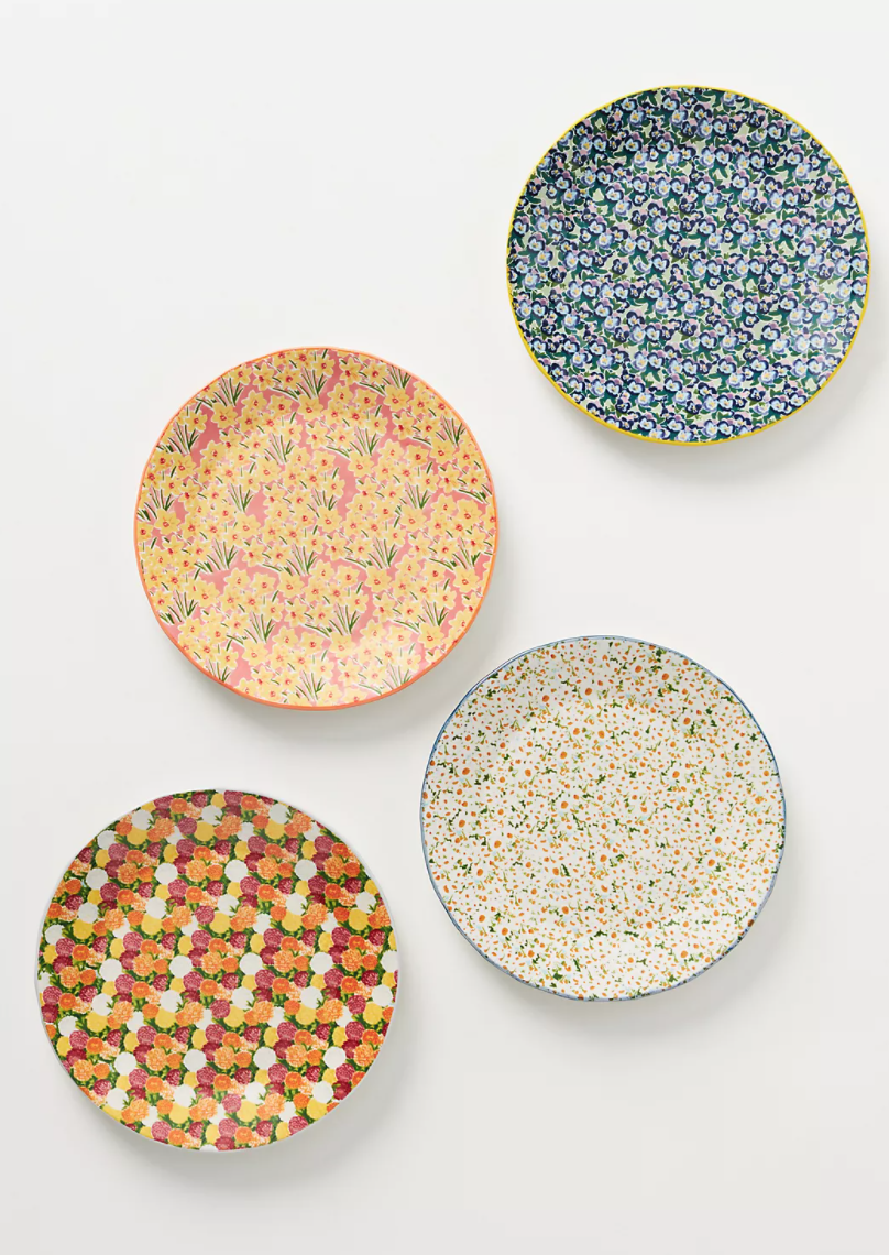 Four floral dessert plates with sweet calico-like designs