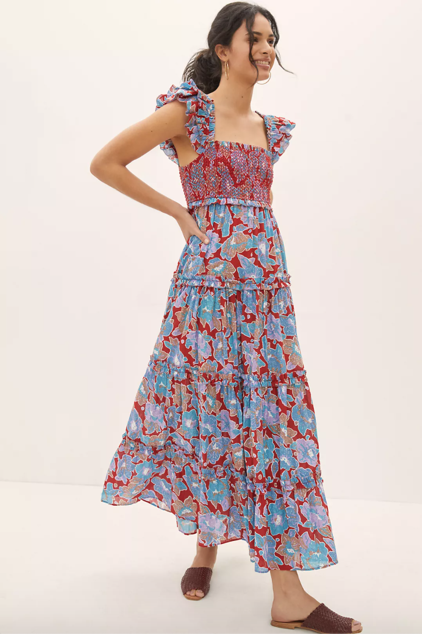 A smocked red and blue floral dress with ruffled sleeves and a smocked bodice