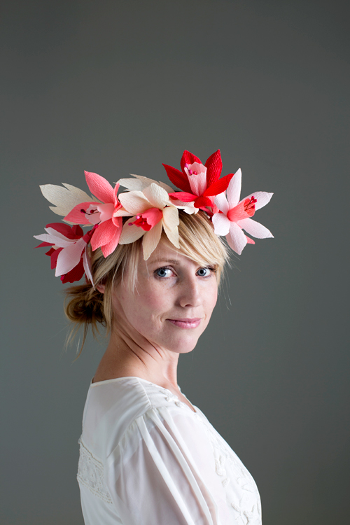 Brittany looks over her shoulder at the camera while wearing a pink, red, and white daffodil crown