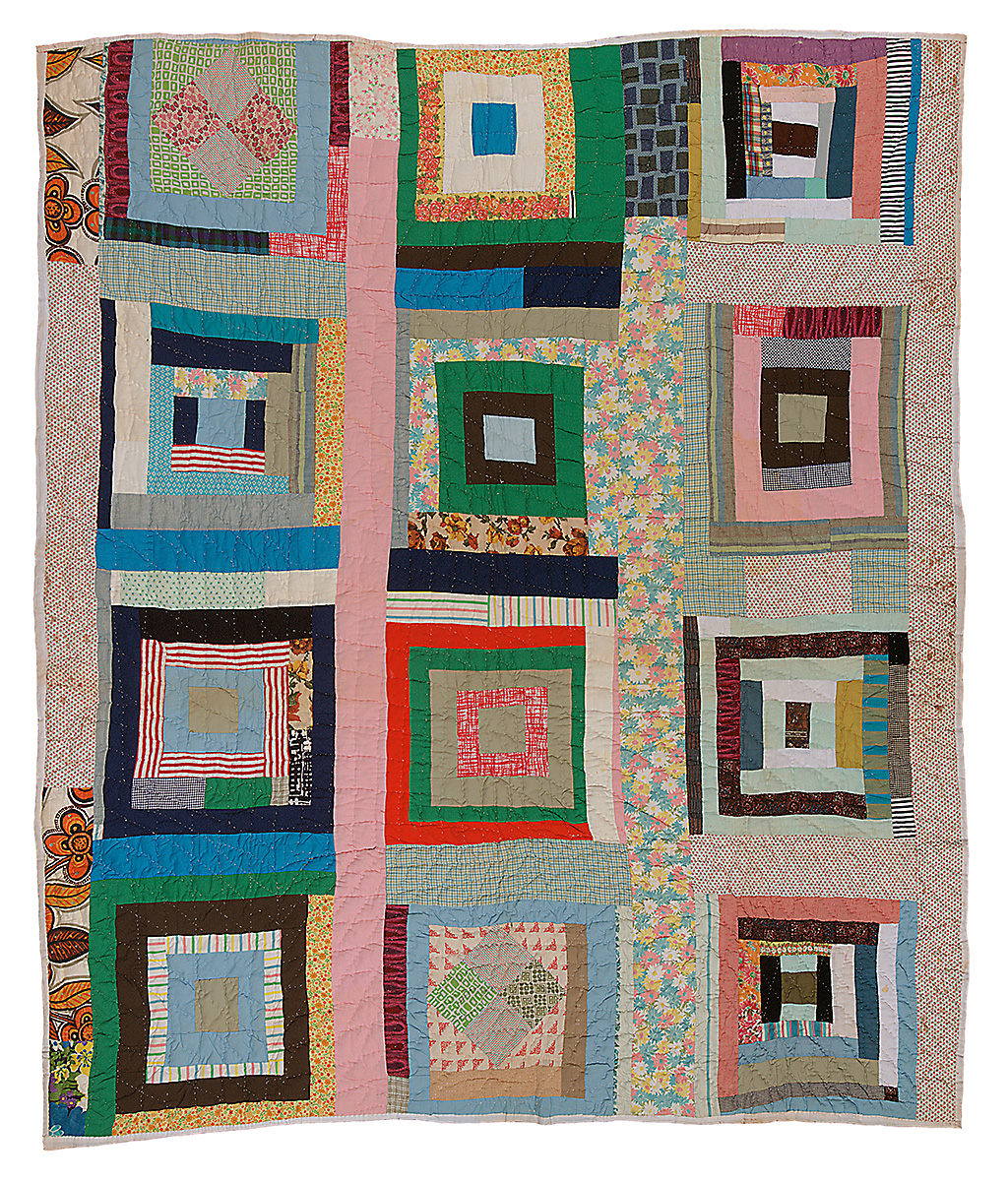 A multicolored quilt made of concentric squares and rectangles.