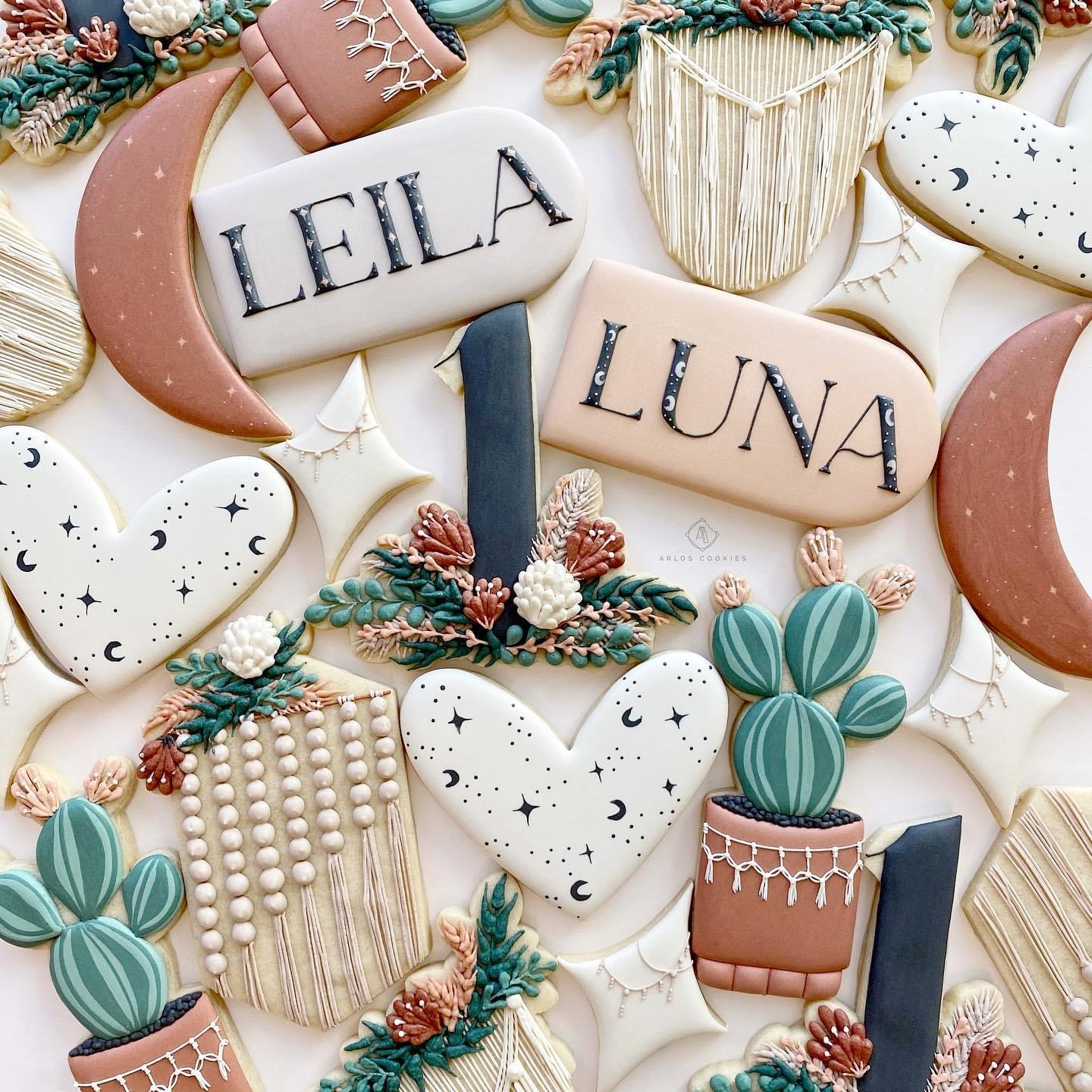 Bohemian-style cookies decorated as hearts, stars, moons, cactuses, macrame hangings, and pendant with names.