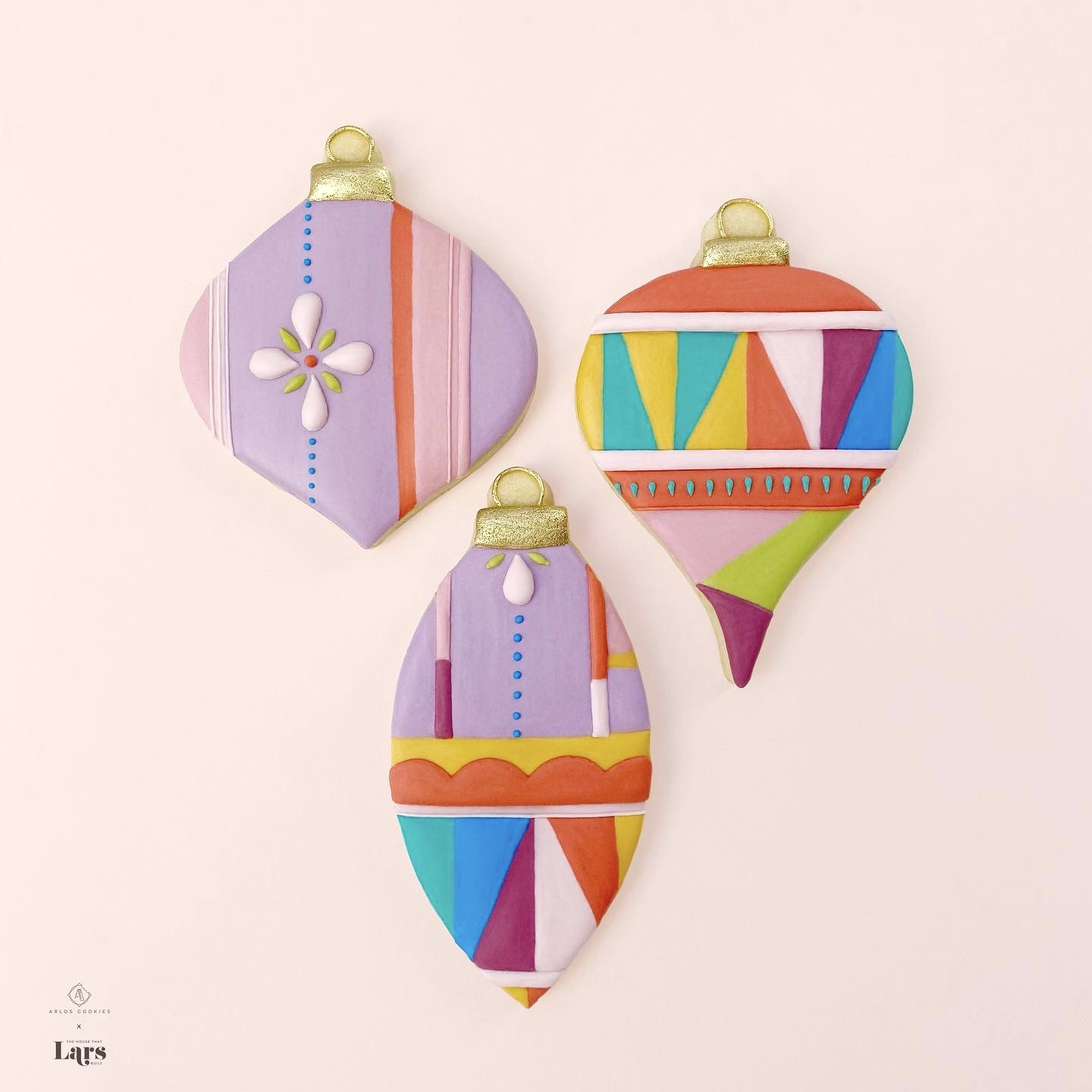 A collaboration between Arlos and Lars! Colorful geometric and floral patterns on ornament-shaped cookies.
