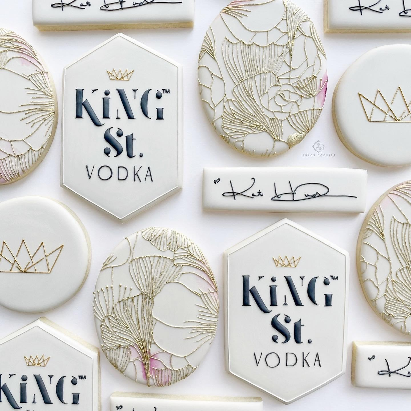 Cookies decorated with floral line drawings and the King St. Vodka logo