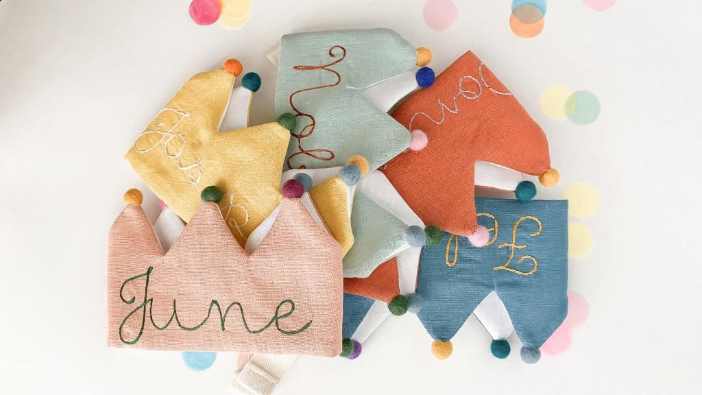 Handmade linen kids birthday crowns in pink, yellow, mint, orange, and blue.
