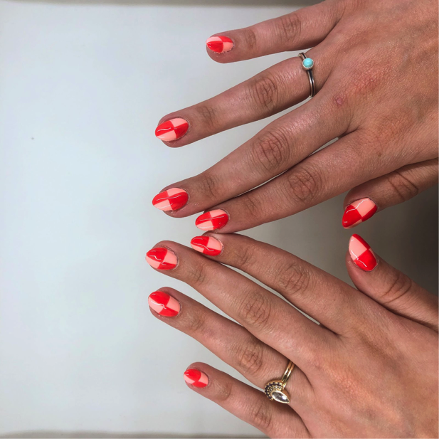 Hailey shows pink and red checkerboard nails.