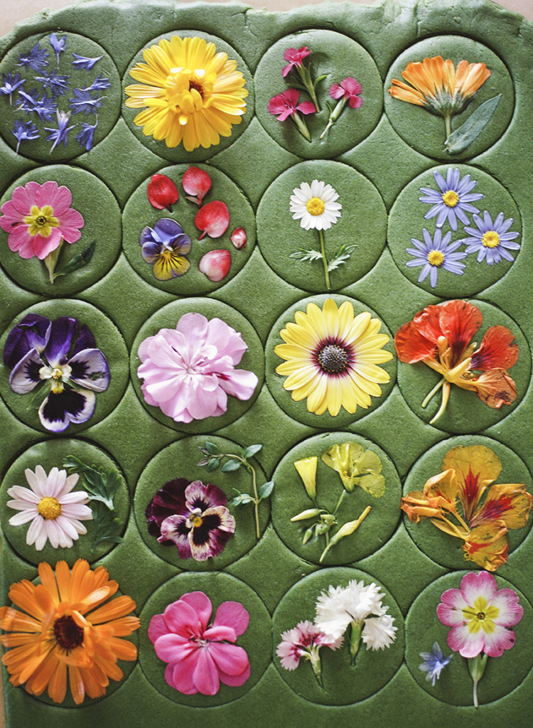 Brightly-colored flowers pressed onto green matcha cookie dough.