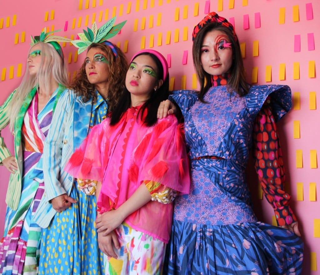 Editorial photo of women modeling Katie Kortman's vibrant designs.