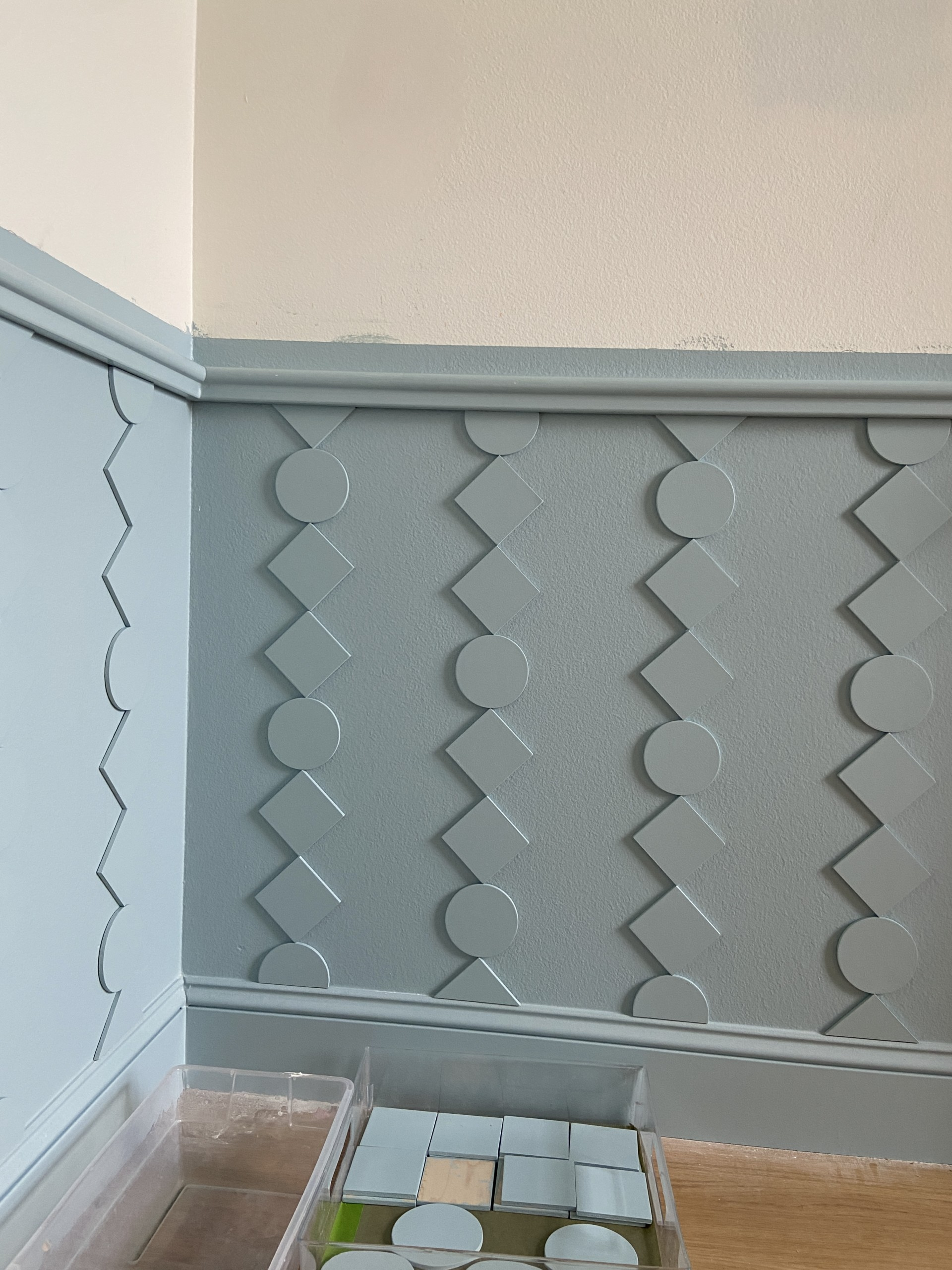 DIY custom wainscoting installed in a blue and white room.
