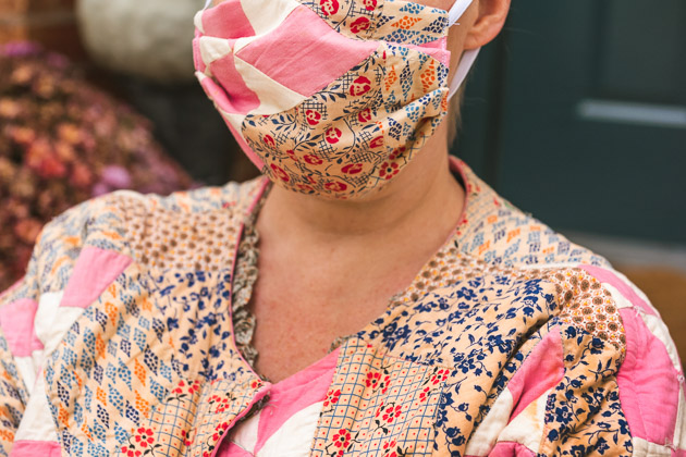 Closeup of Brittany wearing her quilted coat and face mask.